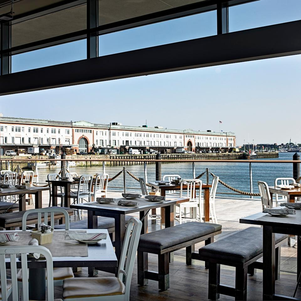 """<p><strong>Give us a top line view this place?</strong><br> Legal Harborside, the 20,000-square-foot <a href=""""https://www.cntraveler.com/activities/boston/seaport-district?mbid=synd_yahoo_rss"""">Seaport District</a> flagship of the iconic 70-year-old Legal Seafood empire, makes it its mission to be all things to all New England seafood lovers. Opened in 2011, the restaurant holds not just one dining destination but a trio of them, one each on three floors. There's an all-day casual spot at street level, more formal and elevated cuisine above, and a rooftop bar and lounge up top.</p> <p><strong>What's the crowd like?</strong><br> The first floor is a bustling and lively melting pot: families, business people who work in the increasingly corporate Seaport, tourists, art-lovers from the nearby Institute of Contemporary Art, concert-goers prior to shows at the music pavilion next door, and neighborhood locals. The quieter, more refined upstairs area draws a mix of business types at at lunch and special-occasion havers at dinner. The rooftop—with its two decks, retractable roof, and glass walls—transitions from a middle-aged crowd to younger professionals as the night goes on.</p> <p><strong>Take us to the bar to start—what should we order?</strong><br> The first floor's most notable offerings are probably the list of proprietary wines, created by noted winemakers just for the restaurant. You'll also find a good selection of beer and craft cocktails. On the second floor, it's all about the 80-plus bottle wine list, mostly from family-owned wineries. The high-end spirits list focuses on whiskeys and cognacs. The rooftop gives you some of Legal's most popular wines and a few proprietary ones, as well, again, beer and cocktails—including seasonal frozen and by-the-pitcher concoctions.</p> <p><strong>On to the seafood. Give us the lowdown—especially what not to miss.</strong><br> The oysters (12 daily varieties) and shellfish platters are where it's at on the first floor, alon"""