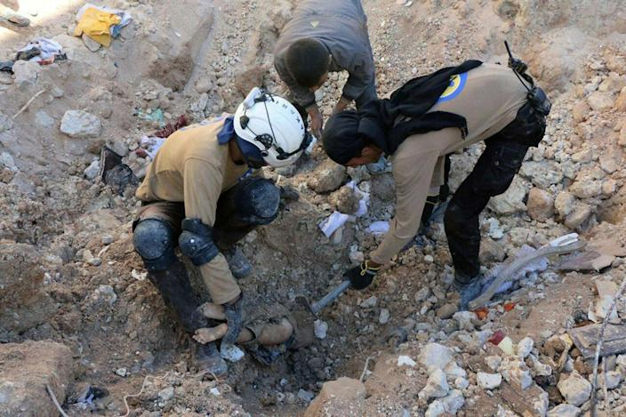<p>SEPT. 24, 2016 — In this photo provided by the Syrian Civil Defense group known as the White Helmets, shows members of Civil Defense removing a dead body from under the rubble after airstrikes hit in Aleppo, Syria. Syrian government forces captured a rebel-held area on the edge of Aleppo on Saturday, tightening their siege on opposition-held neighborhoods in the northern city as an ongoing wave of airstrikes destroyed more buildings. (Syrian Civil Defense White Helmets via AP) </p>