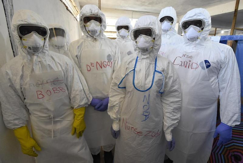 Health workers pose for a photograph at the World Health Organization health center in the Liberian capital Monrovia, on October 3, 2014 (AFP Photo/Pascal Guyot)