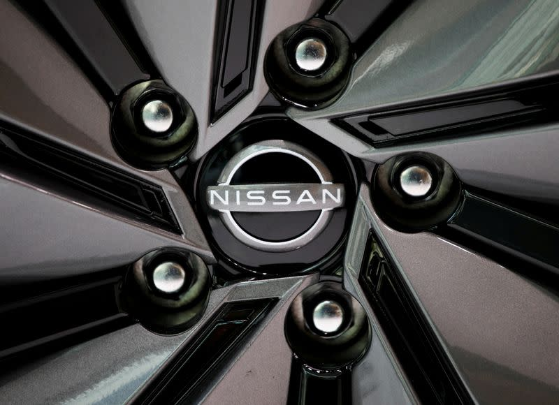 FILE PHOTO: FILE PHOTO: The brand logo of Nissan Motor Corp. is seen on a tyre wheel of the company's car at their showroom in Tokyo