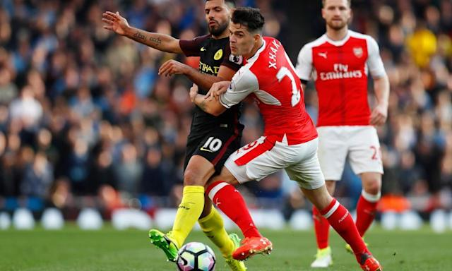 """<span class=""""element-image__caption"""">Arsenal's Granit Xhaka battles with Manchester City's Sergio Agüero during the 2-2 draw at the Emirates.</span> <span class=""""element-image__credit"""">Photograph: Eddie Keogh/Reuters</span>"""