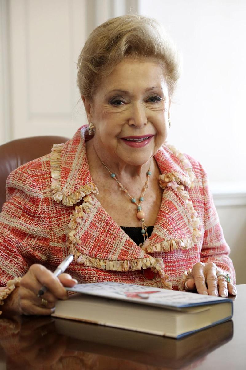 """In this Wednesday, April 3 2013 photo, author Mary Higgins Clark sign copies of her latest book """"Daddy's Gone A Hunting"""" at the Simon & Schuster office in New York. Her current book is a vintage Clark thriller featuring women in distress, mysterious pasts and secret identities. It's about a deadly explosion that destroys a family furniture business in Long Island City. (AP Photo/Mary Altaffer)"""