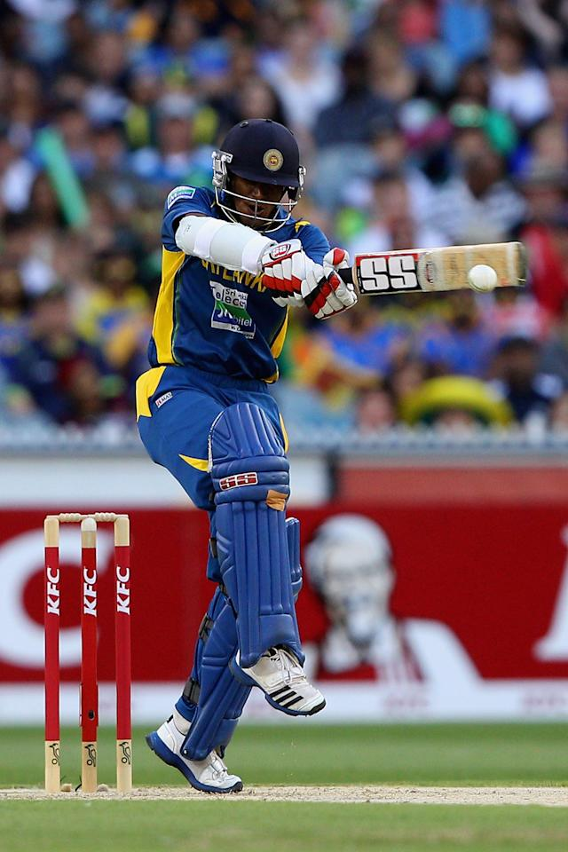 MELBOURNE, AUSTRALIA - JANUARY 28:  Kushal Janith Perera of Sri Lanka plays a shot during game two of the Twenty20 International series between Australia and Sri Lanka at Melbourne Cricket Ground on January 28, 2013 in Melbourne, Australia.  (Photo by Robert Prezioso/Getty Images)