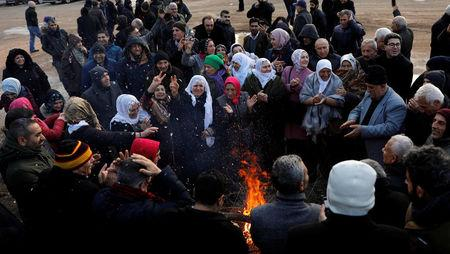 Supporters of Selahattin Demirtas, the jailed leader of the Peoples' Democratic Party (HDP), wait in front of a court house as he went on trial, 13 months after his arrest on terrorism-related charges, in Ankara, Turkey, December 7, 2017. REUTERS/Umit Bektas