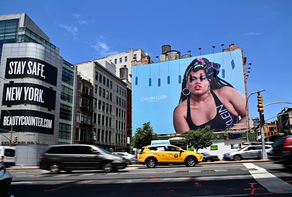 """Cars drive past a New York City billboard featuring Black trans model Jari Jones in a Calvin Klein ad. When Jones' mother saw it, she says, """"she wept."""" (Photo: ANGELA WEISS/AFP via Getty Images)"""