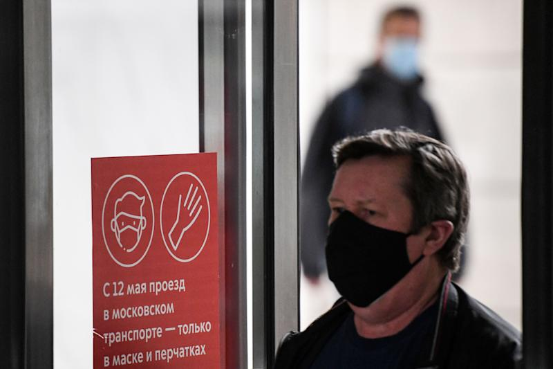 A man wearing a face mask walks at Savyolovskaya metro station on the first day of mandatory use of masks and gloves on Moscow public transport, in Moscow on May 12, 2020, amid the coronavirus pandemic. (Photo by Kirill KUDRYAVTSEV / AFP) (Photo by KIRILL KUDRYAVTSEV/AFP via Getty Images)