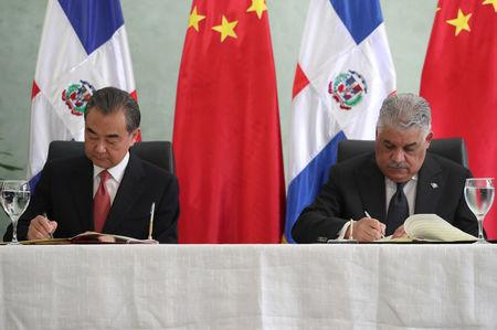 China's Foreign Minister Wang Yi and Dominican Republic's Chancellor Miguel Vargas sign a bilateral agreement in Santo Domingo, Dominican Republic September 21, 2018. REUTERS/Ricardo Rojas
