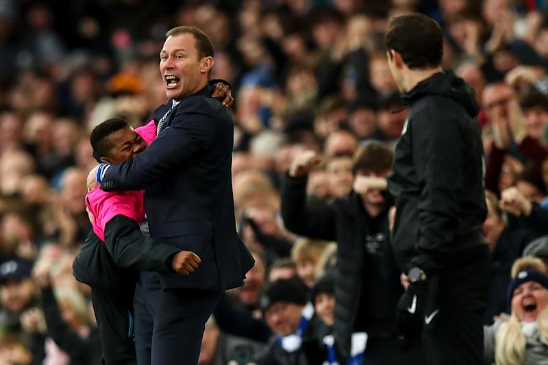 LIVERPOOL, ENGLAND - DECEMBER 07: Duncan Ferguson the interim head coach / manager of Everton celebrates with a ball boy after the second goal during the Premier League match between Everton FC and Chelsea FC at Goodison Park on December 7, 2019 in Liverpool, United Kingdom. (Photo by Robbie Jay Barratt - AMA/Getty Images)