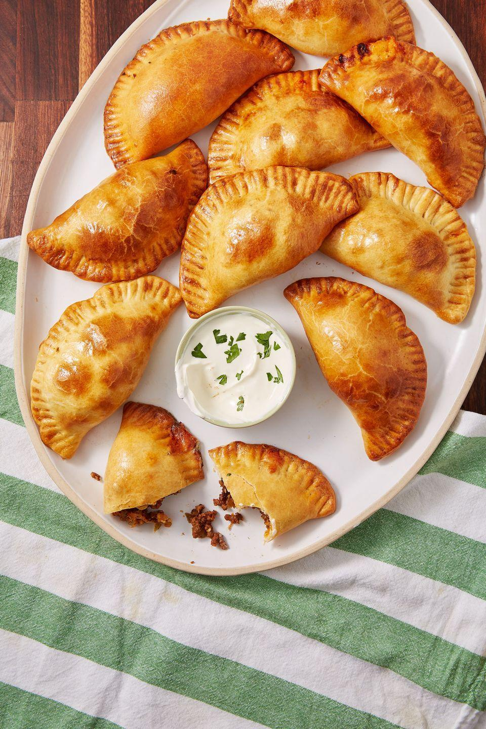 "<p>Everything you could ever want in one convenient pocket.</p><p>Get the recipe from <a href=""https://www.delish.com/cooking/recipe-ideas/recipes/a52606/cheesy-beef-empanadas-recipe/"" rel=""nofollow noopener"" target=""_blank"" data-ylk=""slk:Delish"" class=""link rapid-noclick-resp"">Delish</a>.</p>"