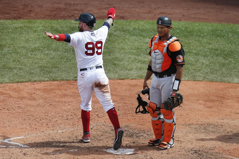 Boston Red Sox's Alex Verdugo (99) scores in front of Baltimore Orioles' Pedro Severino on a single by Red Sox's Kevin Plawecki during the sixth inning of a baseball game Saturday, July 25, 2020, in Boston. (AP Photo/Michael Dwyer)
