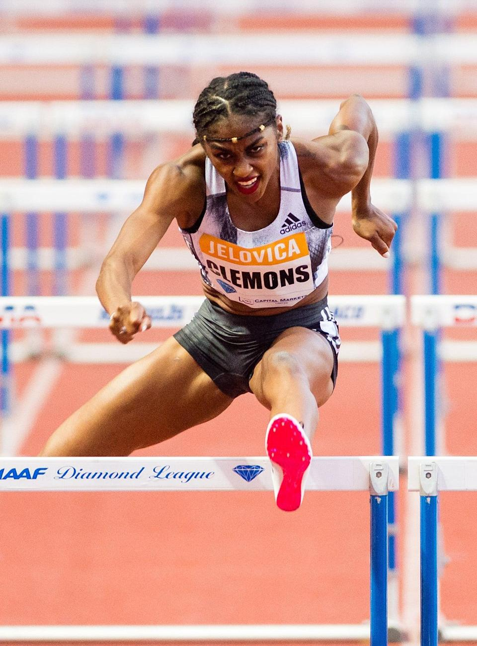 <p>Wearing an embellished crown-like hairstyle and red lipstick and the IAAF Diamond League Meet in 2019.</p>