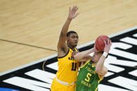 Oregon's Chris Duarte (5) is fouled by Iowa's Tony Perkins (11) as he goes up for a shot during the first half of a second-round game in the NCAA men's college basketball tournament at Bankers Life Fieldhouse, Monday, March 22, 2021, in Indianapolis. (AP Photo/Darron Cummings)