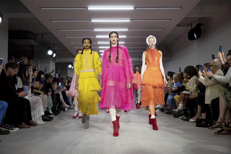 Models wear creations by Bora Aksu at the Spring/Summer 2020 fashion week runway show in London, Friday, Sept. 13, 2019. (Photo by Grant Pollard/Invision/AP)