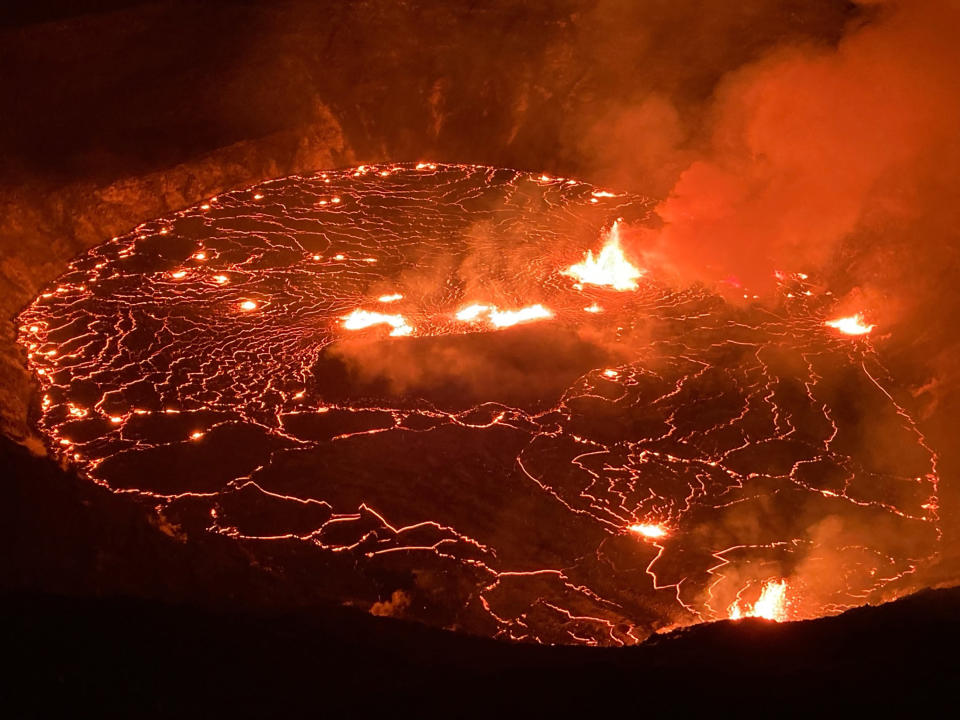 This photo provided by USGS Volcanoes shows the eruption within in Kilauea volcano's Halemaumau crater at the volcano's summit on Wednesday, Sept. 29, 2021. One of the most active volcanos on Earth is erupting on Hawaii's Big Island. O (USGS via AP)