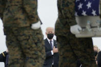President Joe Biden watches as a carry team moves a transfer case containing the remains of Marine Corps Lance Cpl. Kareem M. Nikoui, 20, of Norco, Calif., during a casualty return Sunday, Aug. 29, 2021, at Dover Air Force Base, Del. According to the Department of Defense, Nikoui died in an attack at Afghanistan's Kabul airport, along with 12 other U.S. service members. (AP Photo/Carolyn Kaster)
