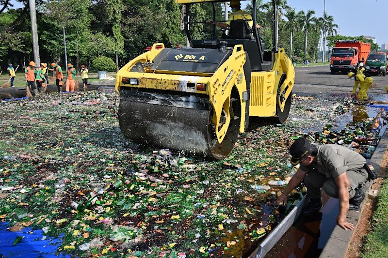 Indonesian authorities make a show of destroying large quantities of illegal alcohol to remind Muslims to abstain from boozing during Ramadan (AFP Photo/ADEK BERRY)