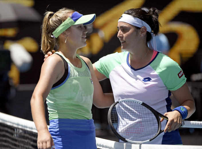 Sofia Kenin, left, of the U.S. is congratulated by Tunisia's Ons Jabeur after winning their quarterfinal match at the Australian Open tennis championship in Melbourne, Australia, Tuesday, Jan. 28, 2020. (AP Photo/Andy Brownbill)