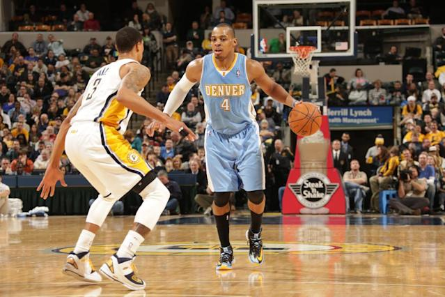 INDIANAPOLIS - FEBRUARY 10: Randy Foye #4 of the Denver Nuggets dribbles the ball against the Indiana Pacers at Bankers Life Fieldhouse on February 10, 2014 in Indianapolis, Indiana. (Photo by Ron Hoskins/NBAE via Getty Images)