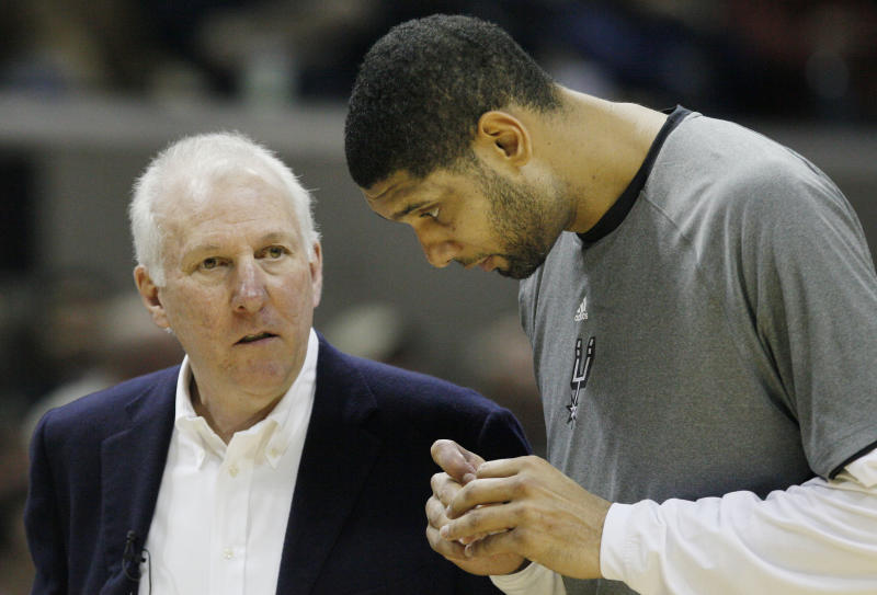 San Antonio Spurs head coach Gregg Popovich, left, talks to Spurs' Tim Duncan during the second half of an NBA basketball game against the Phoenix Suns, Sunday, Jan. 15, 2012, at the AT&T Center in San Antonio. San Antonio 102-91. (AP Photo/Darren Abate)