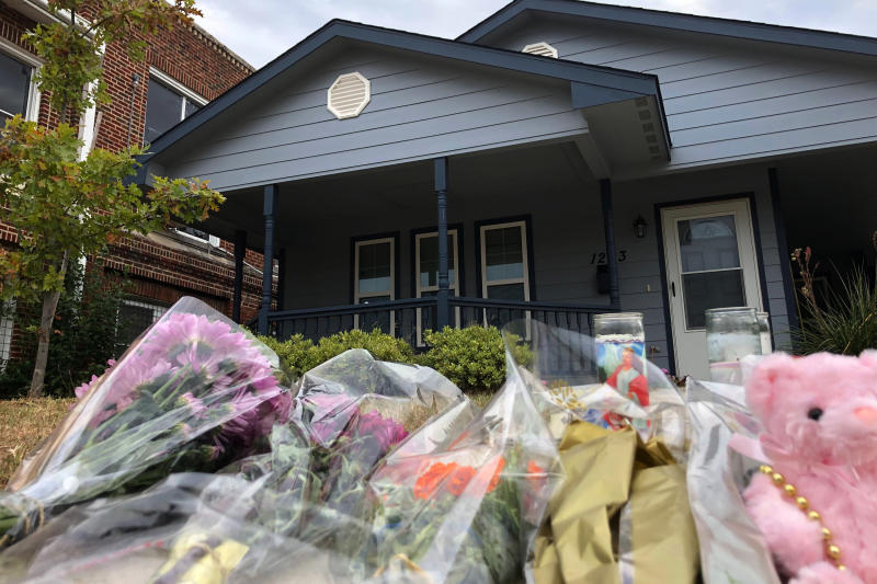 Bouquets of flowers and stuffed animals are piling up outside the Fort Worth home Monday, Oct. 14, 2019, where a 28-year-old black woman was shot to death by a white police officer. Members of the community have brought tributes to the home where Atatiana Jefferson was killed early Saturday by an officer who was responding to a neighbor's report of an open door. | Jake Bleiberg—AP