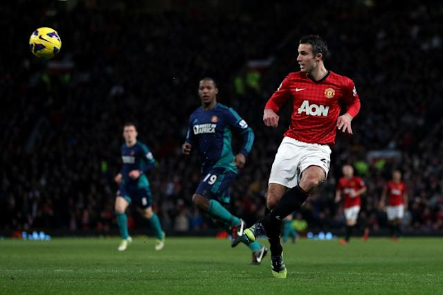 MANCHESTER, ENGLAND - DECEMBER 15: Robin van Persie of Manchester United lobs the ball over the Sunderland goalkeeper to see his effort go wide during the Barclays Premier League match between Manchester United and Sunderland at Old Trafford on December 15, 2012 in Manchester, England. (Photo by Julian Finney/Getty Images)