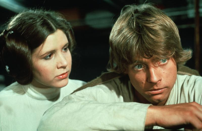 """Star Wars Trilogy"" (1977,1980, and 1983) Carrie Fisher (Princess Leia) and Mark Hamill (Luke Skywalker) (Photo Credit: 20th Century Fox_LucasFilm LTD/Shooting Star) *** Please Use Credit from Credit Field *** HANDOUT / EDITORIAL USE ONLY! Please note: Fees charged by the agency are for the agency's services only, and do not, nor are they intended to, convey to the user any ownership of Copyright or License in the material. The agency does not claim any ownership including but not limited to Copyright or License in the attached material. By publishing this material you expressly agree to indemnify and to hold the agency and its directors, shareholders and employees harmless from any loss, claims, damages, demands, expenses (including legal fees), or any causes of action or allegation against the agency arising out of or connected in any way with publication of the material."