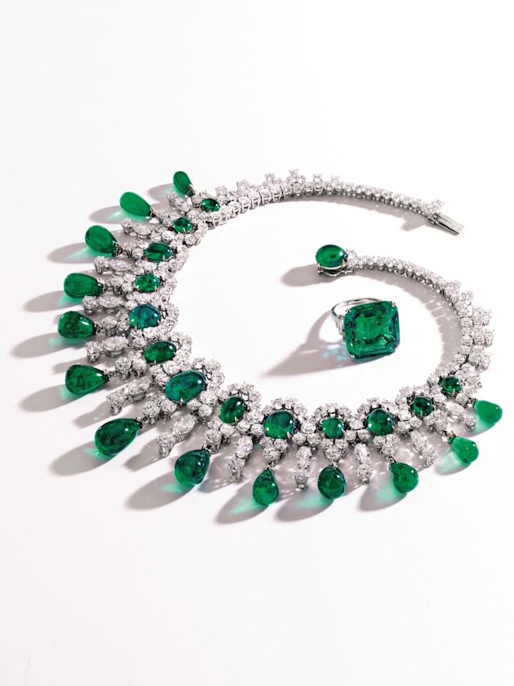 This undated photo provided by Sotheby's shows an emerald and diamond ring and necklace that belonged to the late philanthropist Brooke Astor. Sotheby's said the set will be offered at a New York auction of the late philanthropist's personal items which will include some 800 items to be offered Sept. 24-25 from Astor's Park Avenue duplex and her stone manor in Westchester. (AP Photo/Sotheby's)