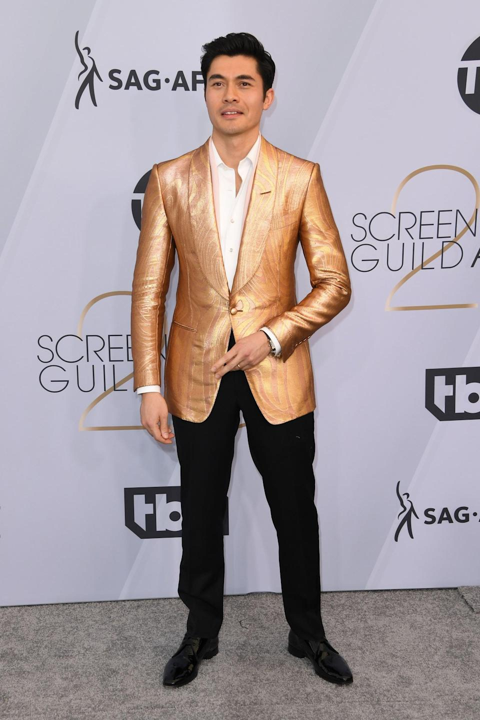 <p>Wearing a gold Tom Ford suit and shoes. </p>