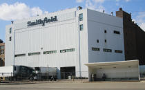 FILE - This April 8, 2020, file photo shows the Smithfield pork processing plant in Sioux Falls, S.D. Hundreds of meatpacking workers have been vaccinated against the coronavirus but the union that represents them says several hundred thousand more have not, despite the risks they continue to face at work. (AP Photo/Stephen Groves, File)