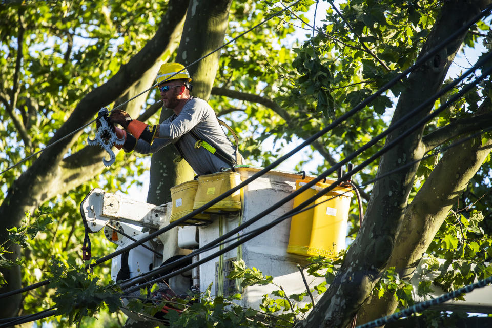BOGOTA, NJ - AUGUST 04: A PSE&G worker works on power lines after Tropical Storm Isaias and its treacherous winds and heavy rain passed through on August 4, 2020 in Bogota, New Jersey. Fallen trees and debris littered the streets across the area, leaving thousands of people without power and disrupting subway service, The storm, which regained hurricane strength Monday night, brought heavy rainfall, lightning, strong winds and flooding to the New York City area on Tuesday afternoon. (Photo by Eduardo Munoz Alvarez/Getty Images)