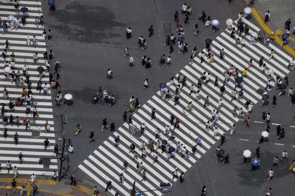 People move to all directions at pedestrian crossings Saturday, July 10, 2021, in Tokyo. The fourth state of emergency would go in effect on Monday and last through Aug. 22, despite the opening ceremony of Tokyo Olympics will be held in less than two weeks. (AP Photo/Kiichiro Sato)