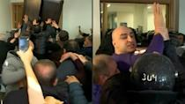Georgian police arrest top opposition leader, use tear gas in party HQ raid