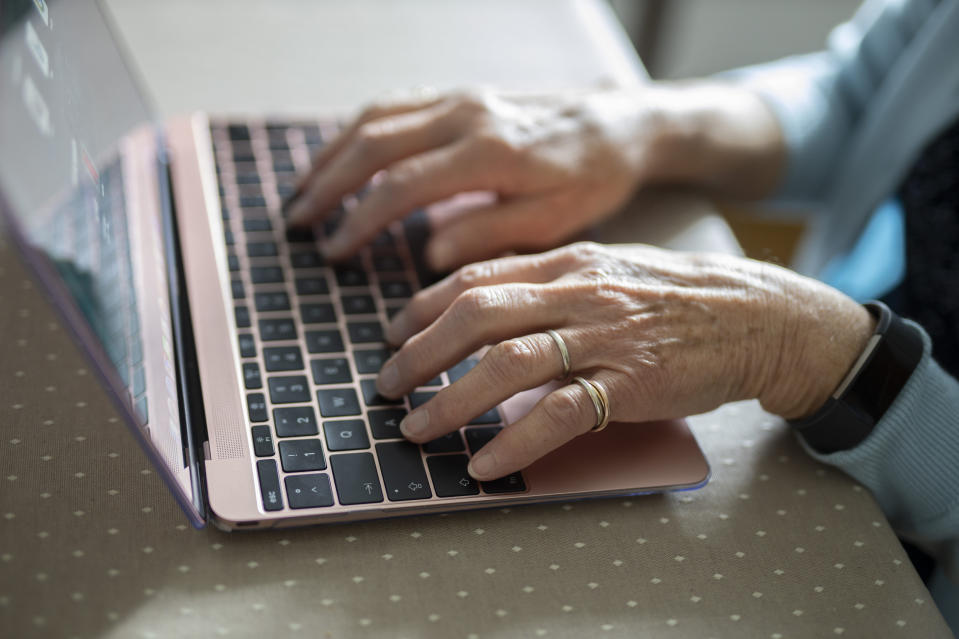 RADEVORMWALD, GERMANY - MAY 12:  In this photo illustration old hand are working on a laptop an old woman is using a laptop on May 12, 2020 in Radevormwald, Germany. (Photo by Ute Grabowsky/Photothek via Getty Images)