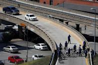 Members of the St. Louis Metropolitan Police Department prevent protesters from entering Interstate 64 after the not guilty verdict in the murder trial of Jason Stockley, a former St. Louis police officer, charged with the 2011 shooting of Anthony Lamar Smith, who was black, in St. Louis, Missouri, U.S., September 15, 2017. REUTERS/Whitney Curtis