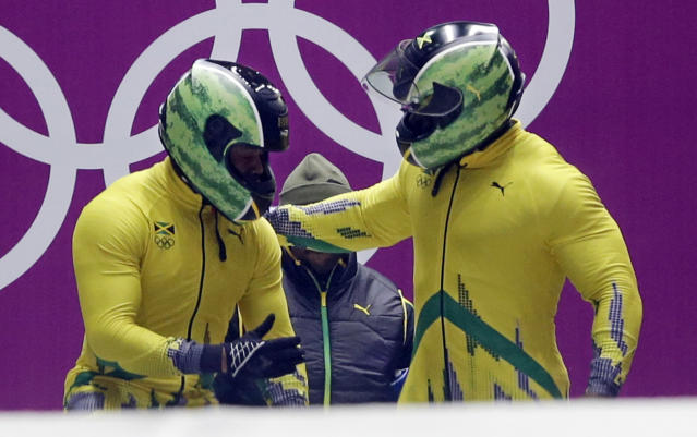 The team from Jamaica JAM-1, piloted by Winston Watts and brakeman Marvin Dixon, prepare to start their first run during the men's two-man bobsled competition at the 2014 Winter Olympics, Sunday, Feb. 16, 2014, in Krasnaya Polyana, Russia. (AP Photo/Dita Alangkara)