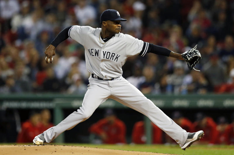FILE - In this Sept. 6, 2019, file photo, New York Yankees' Domingo German pitches during the first inning of the team's baseball game against the Boston Red Sox, in Boston.  Yankees pitcher Domingo German will miss the first 63 games of the 2020 season as part of an 81-game ban for violating Major League Baseball's domestic violence policy. The league announced the suspension Thursday, Jan. 2, 2020. German has agreed not to appeal. (AP Photo/Michael Dwyer, File)