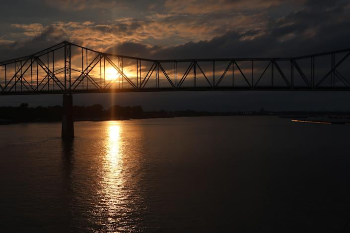 """Cruising at sunset on the American Duchess toward the Ohio River """"Cairo"""" Bridge where the Mississippi and Ohio rivers converge."""