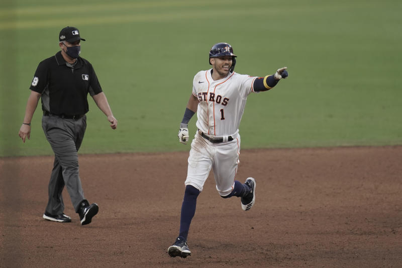 Houston Astros Carlos Correa's celebrates after his walk off home run during the ninth inning in Game 5 of a baseball American League Championship Series, Tuesday, Dec. 15, 2020, in San Diego. The Astros defeated the Rays 4-3 and the Rays lead the series 3-2 games. (AP Photo/Gregory Bull)