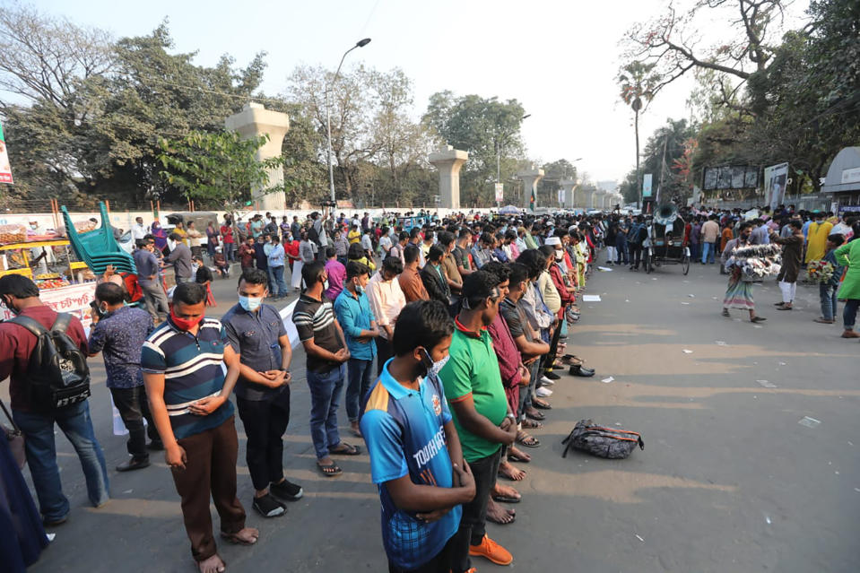 Protesters offer Friday prayers as they protest the death in prison of a writer who was arrested on charges of violating the sweeping digital security, in Dhaka, Bangladesh, Friday, Feb. 26, 2021. Mushtaq Ahmed, 53, was arrested in Dhaka in May last year for making comments on social media that criticized the Prime Minister Sheikh Hasina government's handling of the coronavirus pandemic. He had been denied bail at least six times. (AP Photo/Mahmud Hossain Opu)