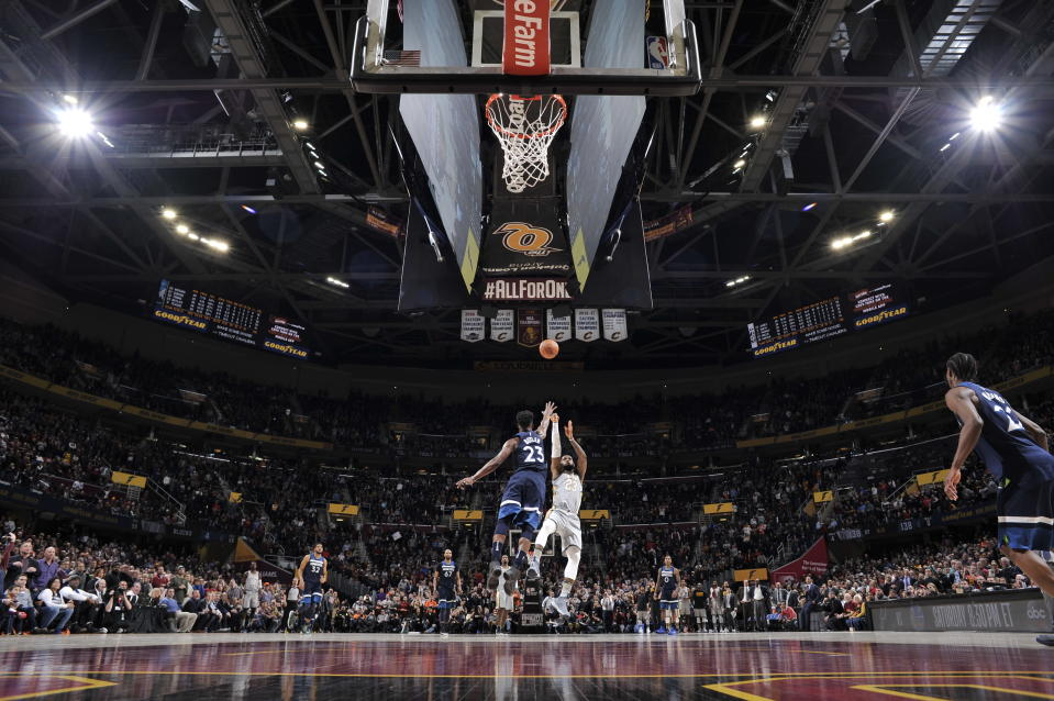 LeBron James shoots the game-winning jumper over Jimmy Butler in the final second of overtime, giving the Cavaliers a thrilling win over the Timberwolves. (David Liam Kyle/NBAE/Getty Images)