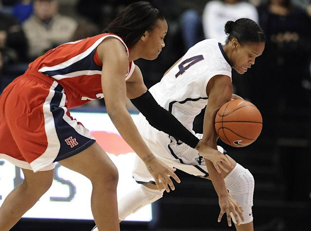 Connecticut's Moriah Jefferson steals the ball from Houston's Jessieka Palmer, left, during the first half of an NCAA college basketball game, Tuesday, Jan. 7, 2014, in Storrs, Conn. (AP Photo/Jessica Hill)