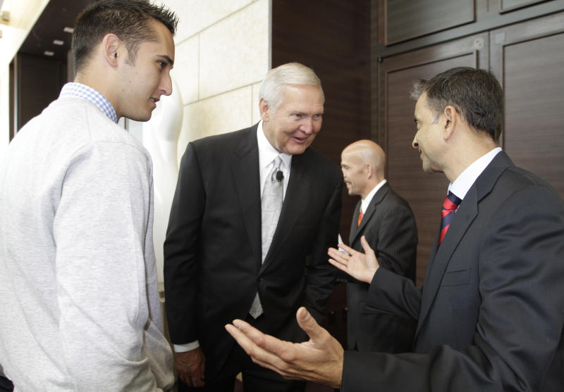 FILE - In this May 23, 2011, file photo, Jerry West, center, a member of the Golden State Warriors basketball club's Executive Board, visits with Warriors partial owner Vivek Rnadive, right, as West's son, Jonnie West, left, looks on before a news conference in San Francisco. Golfer Michele Wie revealed on Instagram earlier this week that she was engaged to Jonnie West, the Golden State Warriors' director of basketball operations and the son of NBA great Jerry West. (AP Photo/Eric Risberg, File)