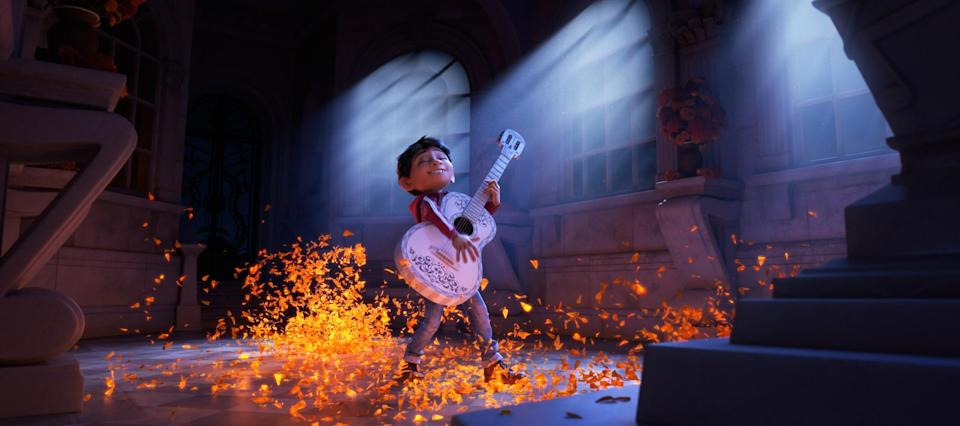 In Pixar's 'Coco', Miguel (Anthony Gonzalez) dreams of becoming an accomplished musician like the celebrated Ernesto de la Cruz (Benjamin Bratt). But when he strums his idol's guitar, he sets off a mysterious chain of events. (Credit: Disney)