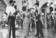 <p>Vanessa Bell Calloway's entrance at the beginning of <em>Coming to America</em> as the intended wife in the arranged marriage with Eddie Murphy's character is unforgettable. Partly due to her downright regal evening gown made of black sheer paneling and gold embroidered lace.</p>