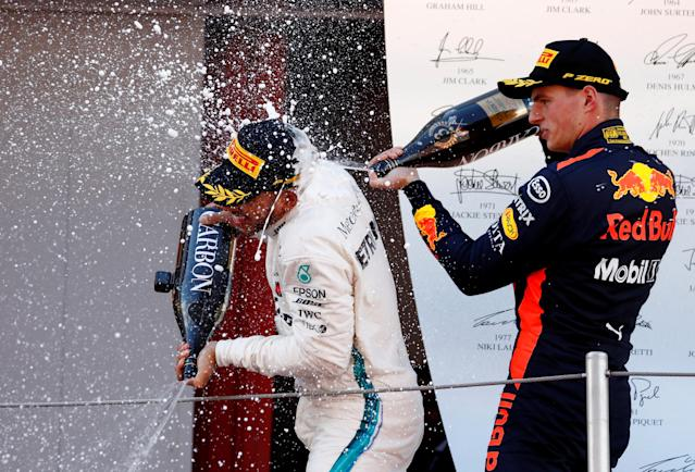 Formula One F1 - Spanish Grand Prix - Circuit de Barcelona-Catalunya, Barcelona, Spain - May 13, 2018 Red Bull's Max Verstappen sprays Mercedes' Lewis Hamilton with champagne as they celebrate on the podium after finishing third and first respectively REUTERS/Juan Medina