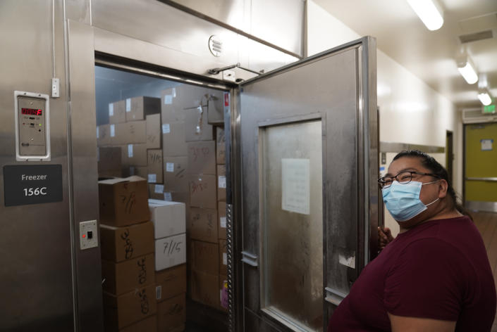Los Angeles Unified School District Food Service manager Rosa Garcia checks food stocks in a walk-in freezer for free school meals on Thursday, July 15, 2021, at the Liechty Middle School in Los Angeles. Flush with cash from an unexpected budget surplus, California is launching the nation's largest statewide universal free lunch program. When classrooms open for the fall term, every one of California's 6.2 million public school students will have the option to eat school meals for free, regardless of their family's income. (AP Photo/Damian Dovarganes)