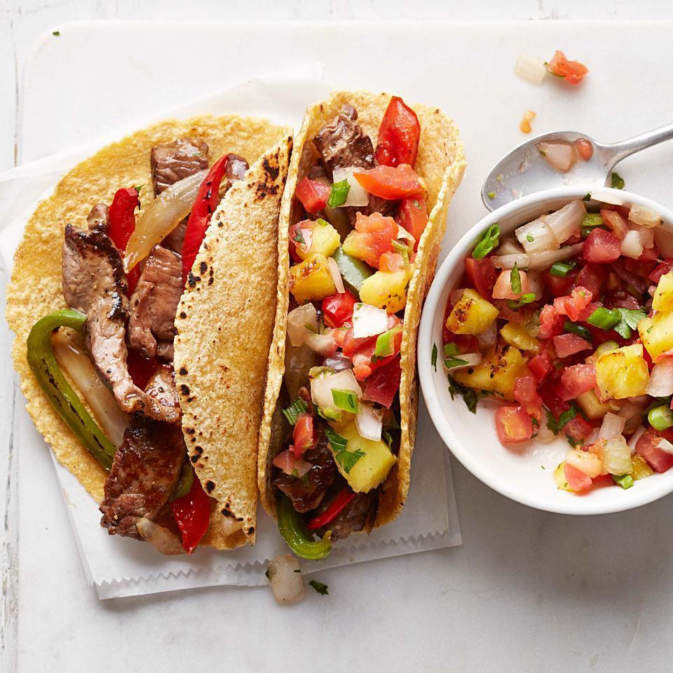 <p>Prepeeled pineapple, presliced peppers and onions and fresh pico de gallo help this quick, healthy dinner recipe come together in a flash. Chicken tenders are a good substitute for the steak if you prefer. Blend up some margaritas and call it a party.</p>