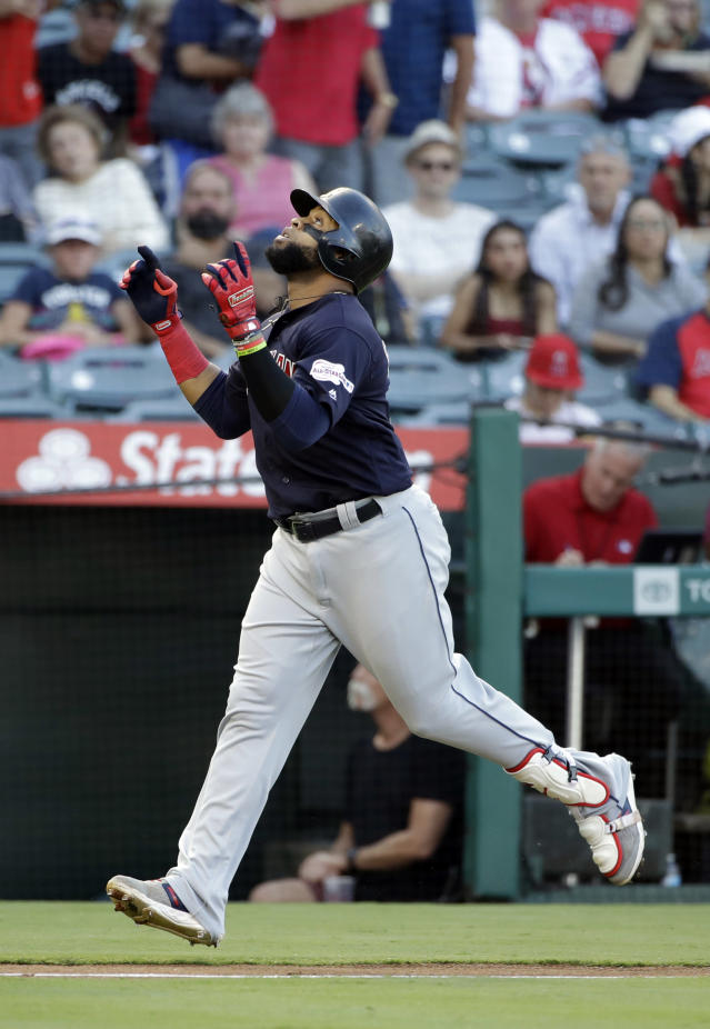 Cleveland Indians' Carlos Santana points skyward as he reaches home plate after his solo home run against the Los Angeles Angels during the first inning of a baseball game Wednesday, Sept. 11, 2019, in Anaheim, Calif. (AP Photo/Marcio Jose Sanchez)