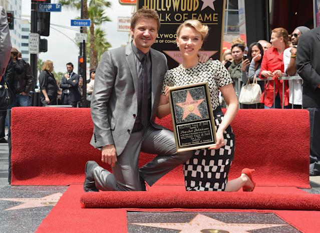 """HOLLYWOOD, CA - MAY 02: Actor Jeremy Renner (L) poses with actress Scarlett Johansson of """"Marvel's The Avengers"""" as she is honored on the Hollywood Walk of Fame on May 2, 2012 in Hollywood, California. (Photo by Alberto E. Rodriguez/WireImage)"""