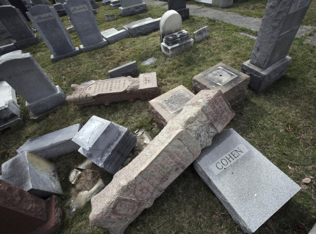 Toppled and damaged headstones at Mount Carmel Cemetery in Philadelphia on Feb. 27. (Photo: Jacqueline Larma/AP)